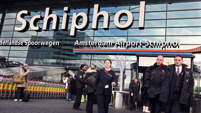 Saturday Dec. 26, 2009 file photo shows security workers leave Schiphol Airport in Amsterdam, Netherlands. (AP Photo/Evert Elzinga)