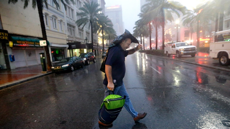 Ronnie Willis makes his way across Canal Street through the wind and rain from Hurricane Isaac in New Orleans Wednesday, Aug. 29, 2012. (AP / David J. Phillip)
