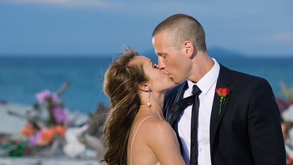 """In this photo provided by ABC, """"Bachelorette"""" Ashley Hebert kisses J.P. Rosenbaum on the season finale of """"The Bachelorette"""" in Fiji. (AP / ABC, Matt Klitscher)"""