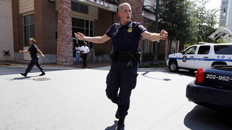 Police push people back from near the front of the headquarters of the Discovery Channel networks building in Silver Spring, Md., Wednesday Sept. 1, 2010. (AP / Jose Luis Magana)