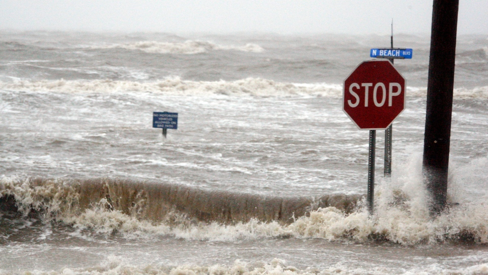 Isaac's winds and storm surge overcomes the seawall and floods Beach Boulevard in Waveland, Miss., Wednesday, Aug. 29, 2012. (AP / Rogelio V. Solis)