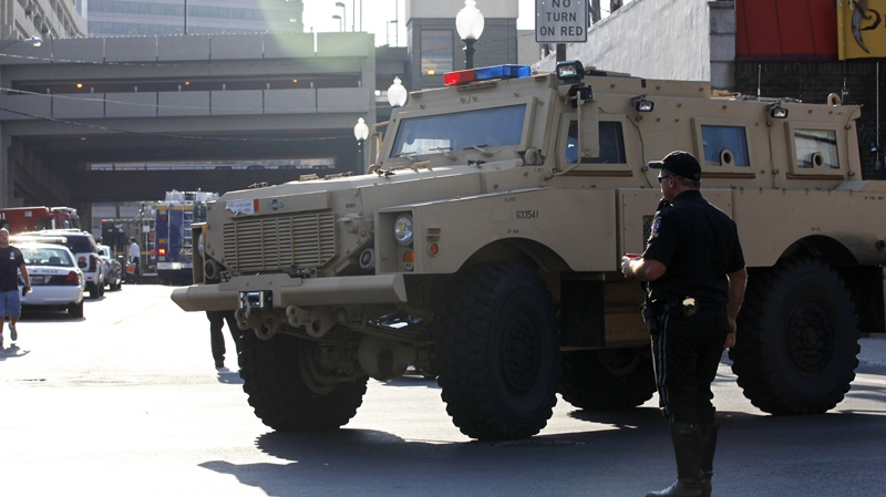 An armoured vehicle drives near the Discovery Channel network's building in Silver Spring, Md., Wednesday, Sept. 1, 2010. (AP / Manuel Balce Ceneta)