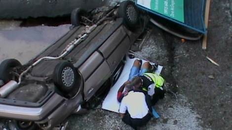 A car plunged into a construction site hole at Main and 30th Avenue in east Vancouver, but witnesses say the driver was able to pull himself from the wreck on Thursday, September 2, 2010. (Special to ctvbc.ca)