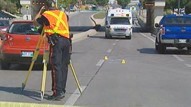 Winnipeg police investigate after a cyclist was hit at Main and York on Aug. 29, 2012.
