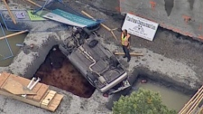 A car plunged into a construction site hole at Main and 31st street in Vancouver, B.C., on Thursday, September 2, 2010. (CTV)