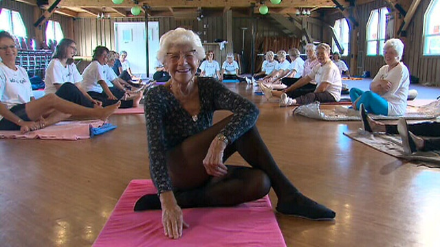 96-year-old Ida Herbert leads a class through yoga movements. The Ontario woman is on her way to setting a Guinness record as the oldest yoga instructor in the world.