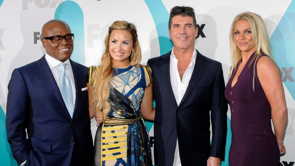 'The X Factor' judges, from left, L.A. Reid, Demi Lovato, Simon Cowell and Britney Spears attend an upfront presentation party at Wollman Rink, Monday, May 14, 2012 in New York. (AP / Evan Agostini)