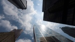 In this file photo, bank skyscrapers are seen from Bay Street in Toronto's financial district. (Adrien Veczan / THE CANADIAN PRESS)