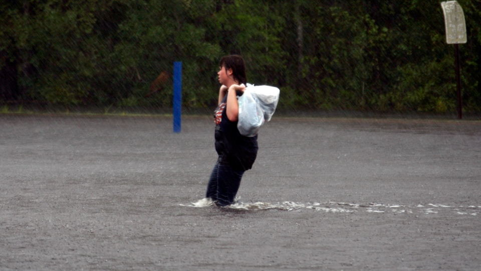 A Waveland, Miss., resident wades through storm waters left from Isaac's unceasing rainstorms to seek shelter, Thursday, Aug. 30, 2012.  (AP / Rogelio V. Solis)