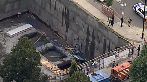 A car plunged into a construction site hole at Main and 30th street in Vancouver, B.C., on Thursday, September 2, 2010. (CTV / Chopper 9)