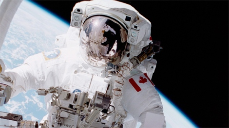 Canadian Space Agency Astronaut Chris Hadfield stands on a restraint connected to Canadarm on space shuttle Endeavour during one of two spacewalks of mission STS-100 in 2001. (NASA)