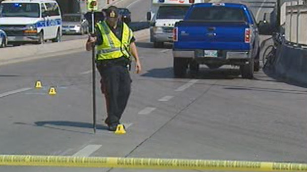 Police investigate the collision between a cyclist and vehicle on Aug. 29 near Main and York in Winnipeg.