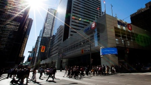 People pass by the Bank of Montreal in Toronto on Tuesday, Aug. 28, 2012. (Michelle Siu / THE CANADIAN PRESS)