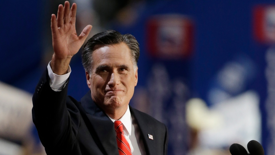 Republican presidential nominee Mitt Romney waves to delegates before speaking at the Republican National Convention in Tampa, Fla., on Thursday, Aug. 30, 2012. (AP /Charlie Neibergall)
