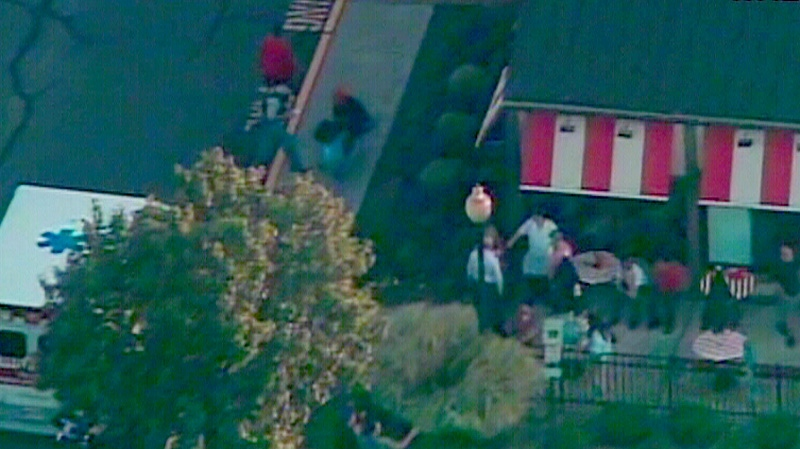 Emergency officials on the scene of a deadly shooting at a New Jersey supermarket, Friday, Aug. 31, 2012.