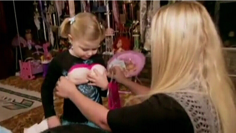 Lindsay Jackson helps her daughter Maddy Verst try out a padded bra