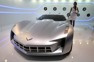 A model stands at the Chevrolet Stingray car at the Moscow International Automobile Salon in Moscow, Russia, Friday, Aug. 31, 2012. (AP Photo/Mikhail Metzel)