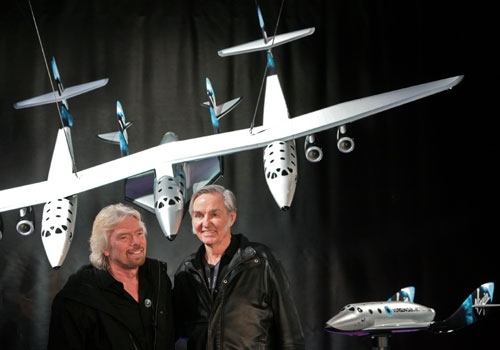 British billionaire Richard Branson, left, and the aerospace designer Burt Rutan unveil a model of SpaceShipTwo, right, the vehicle they hope will be able to take passengers on suborbital joy-rides, just for the fun of it, with test flights beginning as soon as this year, during a news conference in New York, Wednesday, Jan. 23, 2008. (AP Photo / Bebeto Matthews)