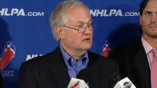 Donald Fehr, Executive Director of the NHLPA, speaks with the press