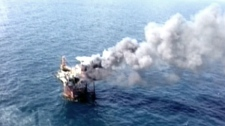 Flames are seen from the oil and gas platform that exploded in the Gulf of Mexico, off the coast of Louisiana.,Thursday, Sept. 2, 2010.