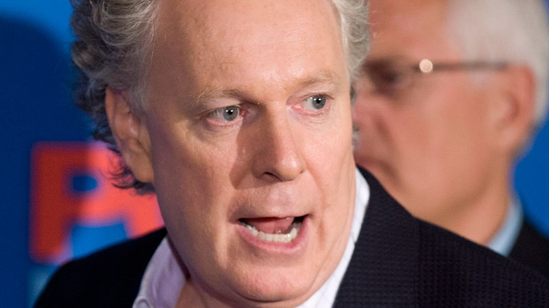Quebec Liberal Party leader Jean Charest speaks to supporters at a breakfast meeting in Saguenay, Que., on Saturday, Sept. 1, 2012. (Jacques Boissinot / THE CANADIAN PRESS)