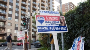For sale signs stand in front of a condominium in Montreal, Tuesday, Sept. 27, 2011. (Ryan Remiorz / THE CANADIAN PRESS)