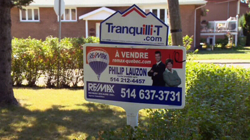 A for sale sign is shown in front of a residence in Montreal, Saturday, Sept. 1, 2012.