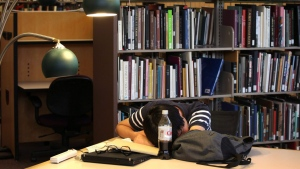 Taewon Kim, an electrical engineering systems graduate student, sleeps in the library on the campus of on  July 11, 2012. (AP / University of Michigan School of Engineering, Marcin Szczepanski)