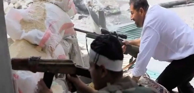 In this image made from video and accessed Saturday, Sept. 1, 2012, Free Syrian Army fighters engage with Syrian troops in Aleppo, Syria. (AP Photo via AP video)
