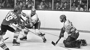 Team Canada's Paul Henderson (left) shoots on Team USSR's Vladislav Tretiak while Gannady Tsygankov defends during the 1972 Summit tournament in Toronto on Sept. 4, 1972. (Peter Bregg / The Canadian Press)