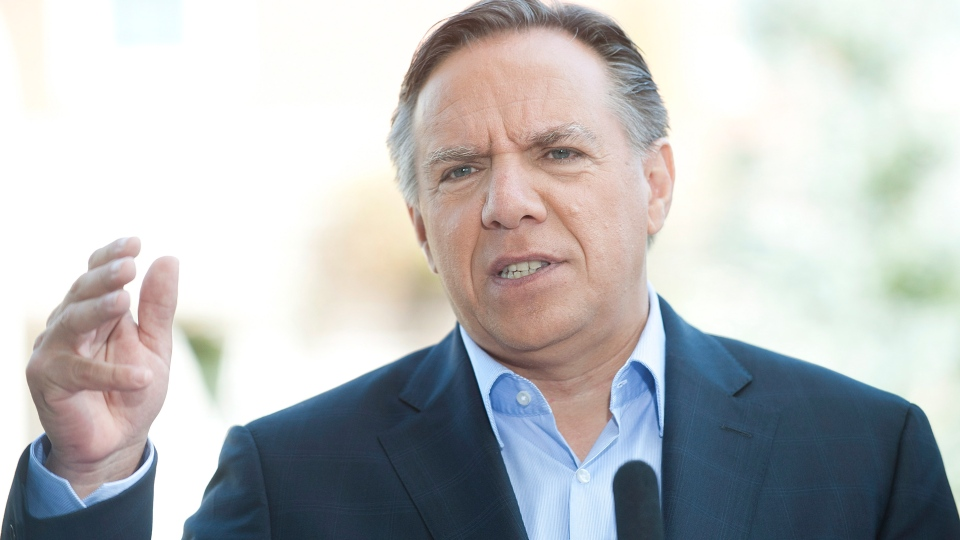 Coalition Avenir Quebec leader Francois Legault speaks to reporters during an election campaign stop in Becancour, Que., on Sunday Sept. 2, 2012. (Graham Hughes / THE CANADIAN PRESS)