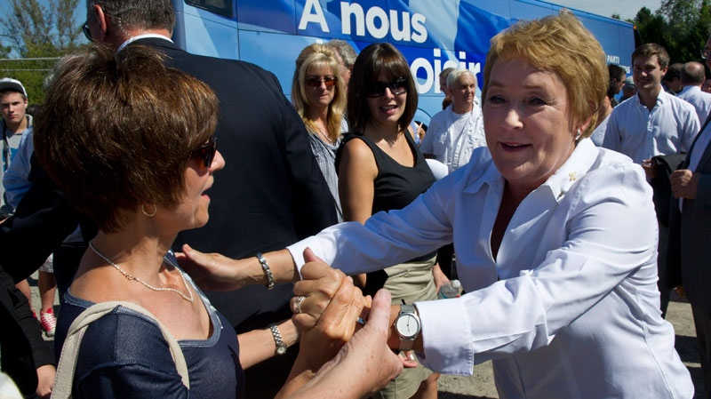 PQ leader Pauline Marois greets supporters during a campaign stop in St-Jerome, Que., Sunday, Sept. 2, 2012. (Paul Chiasson / THE CANADIAN PRESS)