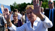 PQ leader Pauline Marois greets supporters during a campaign stop Sunday, September 2, 2012 in St-Je