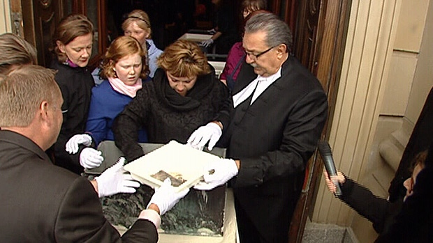 Contents from a century-old time capsule is revealed during the Alberta Legislature building's 100th birthday party.