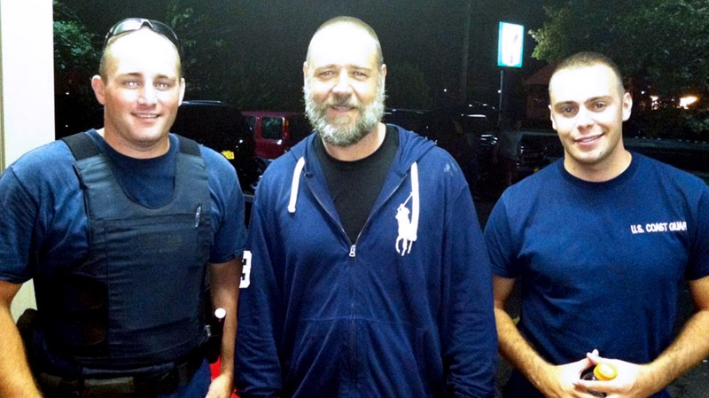 A photo provided by the U.S. Coast Guard shows Russell Crowe, centre, with Coast Guard petty officers Robert Swieciki, left, and Thomas Watson, Sunday, Sept. 2, 2012. (AP / U.S. Coast Guard)