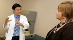 In this Wednesday May 27, 2009 photo, Dr. Patrick Hwu, left, talks with his cancer patient Hilde Stapleton during an examination at The University of Texas MD Anderson Cancer Center in Houston. (AP / David J. Phillip)