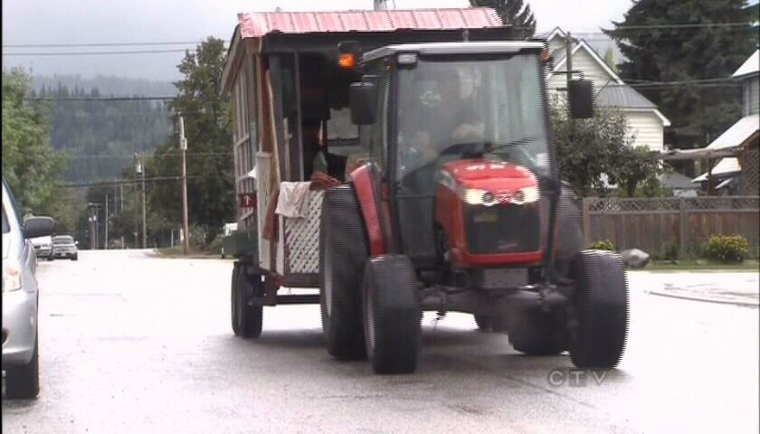 John Varty and his partner Molly Daley are shown driving in their tractor in Revelstoke, B.C. on Saturday, Sept. 1, 2012.