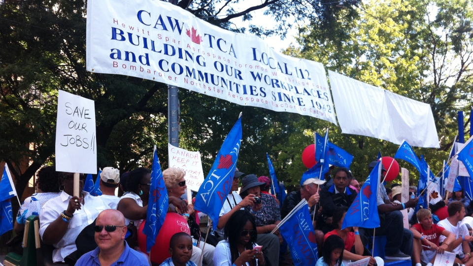 CAW members and supporters take part of the Labour Day parade in Toronto on Monday, Sept. 3, 2012. (Colin D'Mello / CTV News)