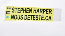Anti-harper banner over Ottawa