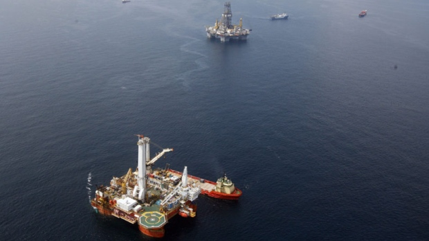 In this Sept. 4, 2010 picture, the Helix Q4000, bottom, the vessel responsible for lifting the Deepwater Horizon blowout preventer stack from the sea floor, is seen on the Gulf of Mexico near the coast of Louisiana. (AP Photo/Patrick Semansky)