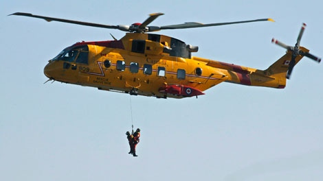 FILE - Search and rescue technicians are hoisted by a Cormorant helicopter during a Canada-United States coast guard ceremony in Halifax on Thursday, Sept. 28, 2006. (Andrew Vaughan / THE CANADIAN PRESS)