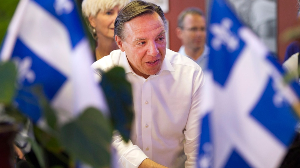 Coalition Avenir Quebec leader Francois Legault speaks to supporters while campaigning Monday, September 3, 2012 in Saint Jerome, Que. Quebecers go to the polls Sept.4, 2012 in a provincial election. (Ryan Remiorz/THE CANADIAN PRESS)