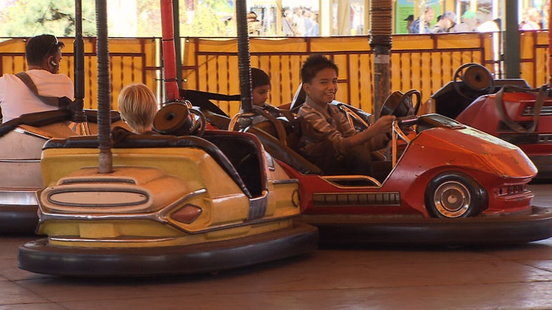Kids play with bumper cars at the Pacific National Exhibit in Vancouver. Sept. 3, 2012. (CTV)