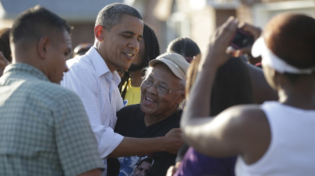President Barack Obama greets local residents as he tours LaPlace, La., after Hurricane Isaac on Monday, Sept. 3, 2012. (AP Photo/Pablo Martinez Monsivais)