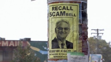 Posters criticizing B.C. Premier Gordon Campbell have been appearing in East Vancouver since last week, when controversial HST documents were released to the media. Sept. 6, 2010. (CTV)