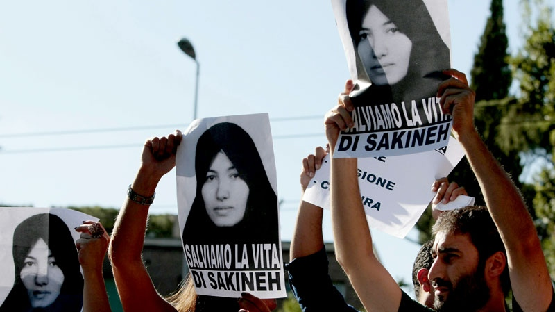 Demonstrators hold portraits of Iranian woman Sakineh Mohammadi Ashtiani during a protest in front of the Iran embassy in Rome, Thursday, Sept. 2, 2010. (AP / Gregorio Borgia)