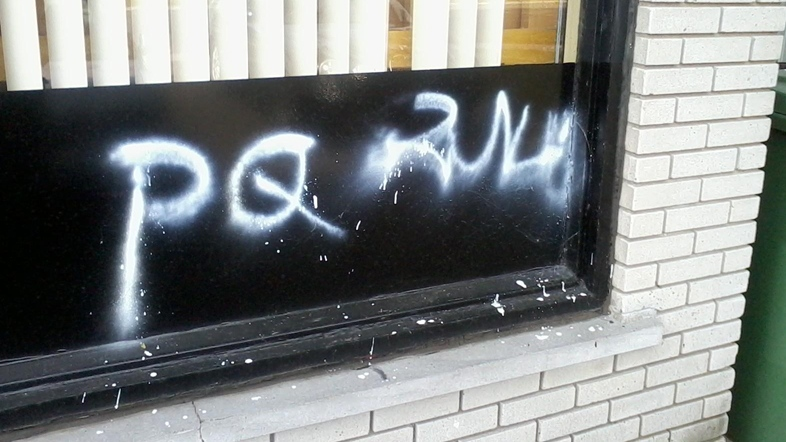 "Vandals spray painted the words ""PQ Rules"" on the side of the West Island Black Community Association in Montreal on Sept. 4, 2012. A note with a racist slur was also left in the association's mailbox. (Photo courtesy: CTV Montreal)"