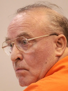 Ernst Zundel listens to statements during his detention review with the Immigration and Refugee Board in Niagara Falls, Ont. on March 31, 2003. (CP / Aaron Harris)