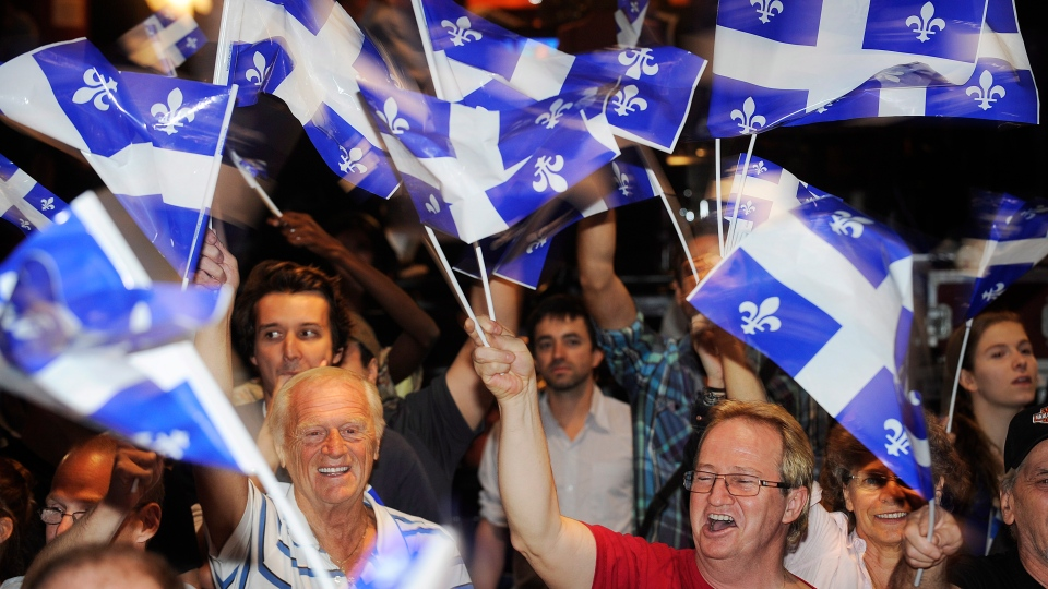 Parti Quebecois supporters cheer as election results are announced in Montreal, Tuesday, Sept. 4, 2012. (Graham Hughes / THE CANADIAN PRESS)