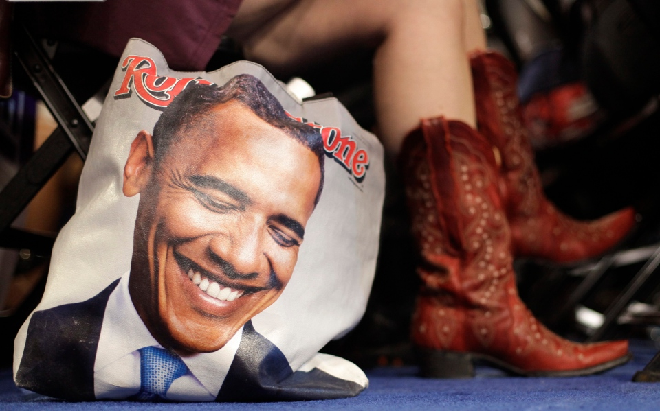 Colorado delegate Tracy Ducharme from Colorado Springs wears cowboy boots as she sit next to her bag showing President Barack Obama during the Democratic National Convention in Charlotte, N.C., on Tuesday, Sept. 4, 2012. (AP Photo/David Goldman)